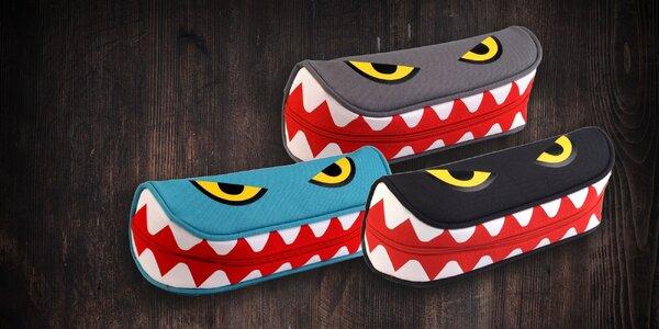 Púzdro s vtipným dizajnom zubatej príšery