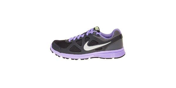 Dámske tmavo šedé bežecké topánky Nike Revolution s fialovými detailami
