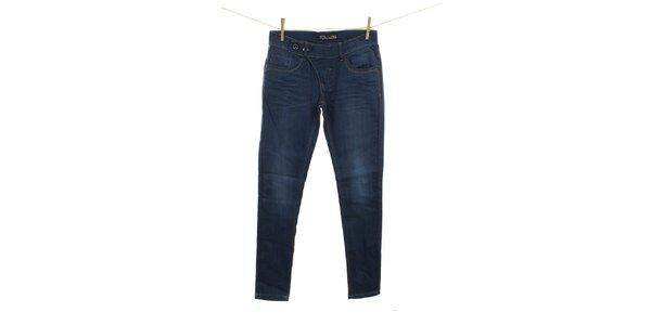 Dámske tmavo modré džínsy s asymetrickým zapínaním Fuga