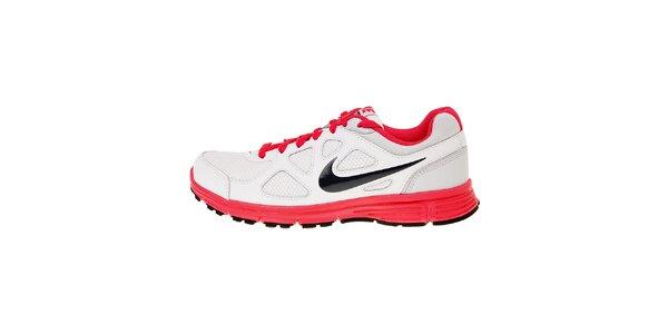 Dámske biele bežecké topánky Nike Revolution s ružovými detailmi