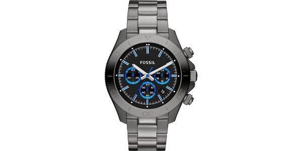Pánske kovovo šedé analogové hodinky s modrými detailmi Fossil
