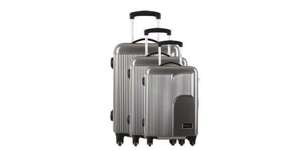 Sada troch striebornošedých kufrov s reliéfnym logom Renoma