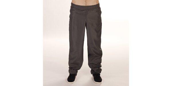 Pánske športové nohavice v khaki farbe Reebok