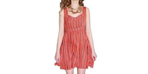 Dámske oranžové šaty s potlačou Liquorish