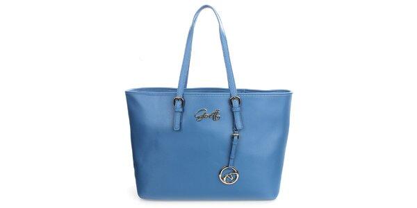 Dámska blankytno modrá kabelka s príveskom Gorétt