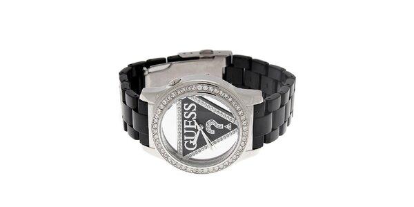 Dámske černo-striebornej náramkové hodinky Guess s transparentným ciferníkom