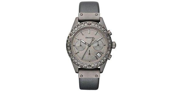 Dámske dymovo šedé oceľové hodinky DKNY s koženým remienkom