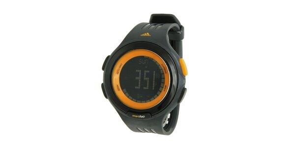 Čierne športové digitálne hodinky Adidas s oranžovými detailami
