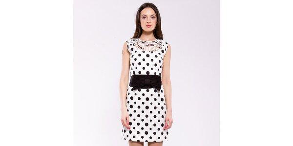 Dámske čierno-biele bodkované šaty Almatrichi s prestrihmi