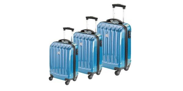 Set troch modrých lesklých pevných kufrov na koliečkach Valisa