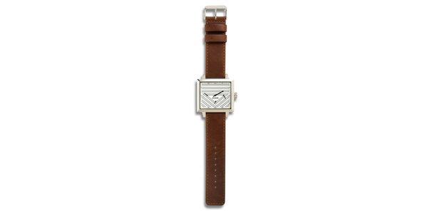 Dámske oceľové hodinky s hnedým koženým remienkom a analógovým ciferníkom 666…