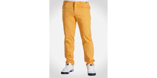 Pánske oranžové nohavice Skank