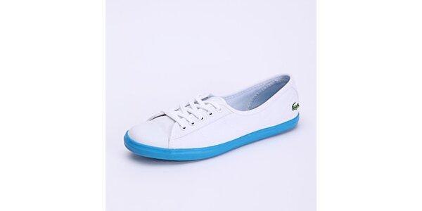 9b6334ed2c75 Dámske topánky Lacoste – športová klasika s logom krokodíla. Táto kampaň už  skončila. Dámske biele tenisky s modrou podrážkou Lacoste