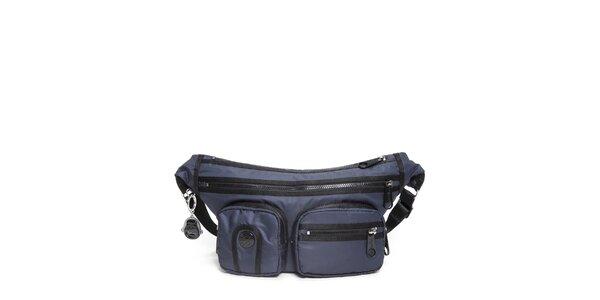 Šusťáková kabelka Kipling v modrej farbe s vreckami