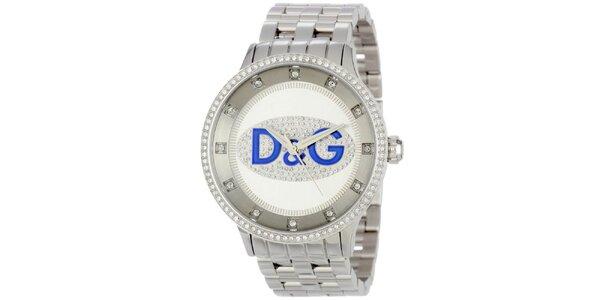 Dámske hodinky s okrúhlym púzdrom osadeným zirkónmi a logom Dolce & Gabbana