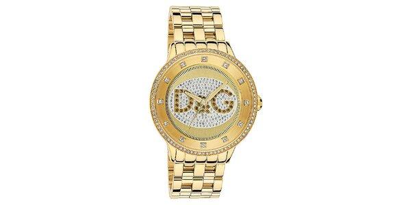 Dámske hodinky s okrúhlym púzdrom osadeným zirkónmi a logom v zlatej farbe…