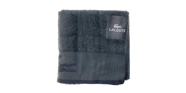 oceľovo modrý uterák Lacoste