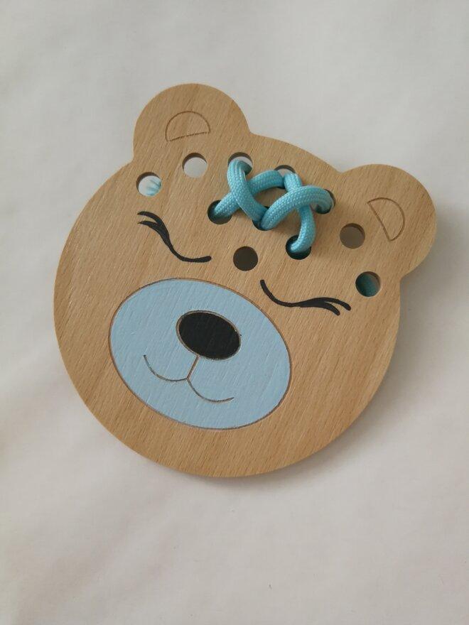 Edukačná prevliekacia hračka (modrý medvedík)