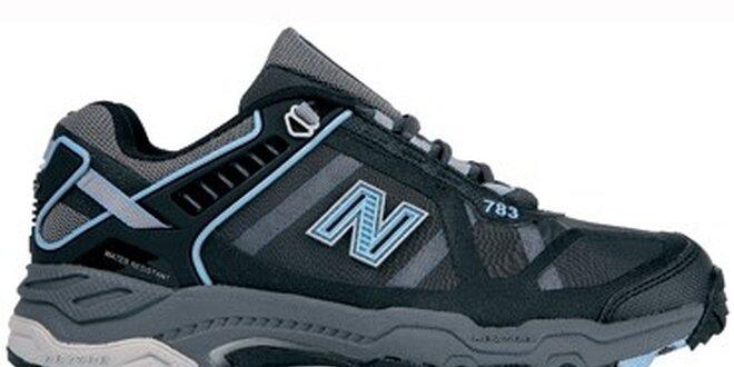 Dámske čierne terénne bežecké tenisky New Balance s modrými detailami