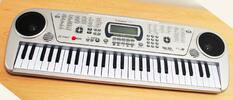 Prenosné klávesy s mikrofónom